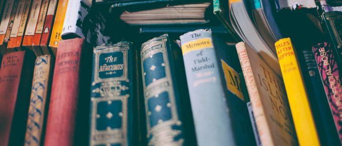 a bookshelf with story books