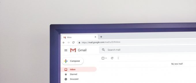 desktop computer with gmail open